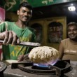 Man cooking chapatis in  India — Stock Photo #62672831