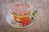 Goji fresh antioxidant tea on wooden background — Stock Photo