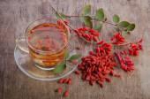 Goji fresh antioxidant tea on wooden background — Stock Photo