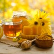 Still life from cup of tea , lemon, honey, wax , honeycombs and  — Stock Photo #62546857