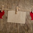 Two Red fabric hearts with sheet of paper hanging on the clothes — Stock Photo #62615603