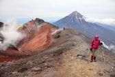 Alpinist on the top of Avachinskiy volcano. — Stock Photo