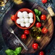 Cherry tomatoes, basil leaves, mozzarella cheese and olive oil f — Stock Photo #52943257