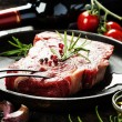 Raw beef steak and wine — Stock Photo #56056727