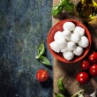 Cherry tomatoes, basil leaves, mozzarella cheese and olive oil f — Stock Photo #58690371