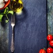 Cherry tomatoes, basil leaves, mozzarella cheese and olive oil f — Stock Photo #58690375