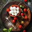 Cherry tomatoes, basil leaves, mozzarella cheese and olive oil f — Stock Photo #59198161