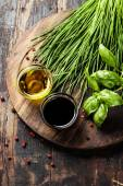 Herbs and spices on wooden board — Stock Photo