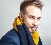 Elegant & Positive young handsome man in colorful scarf. Studio fashion portrait. — Stock Photo