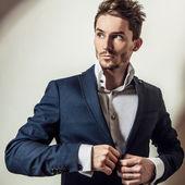 Elegant young handsome man in classic costume. Studio fashion portrait. — Stock Photo