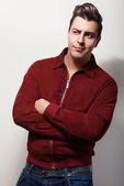 Elegant young handsome man in claret suede jacket. Studio fashion portrait. — Stock Photo