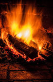 Fireplace with a blazing fire. Photo. — Stock Photo
