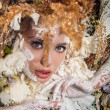 Fairy tale girl portrait surrounded with natural plants and flowers. Art image in bright fantasy stylization. — Stock Photo #77311594