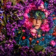 Fairy tale girl portrait surrounded with natural plants and flowers. Art image in bright fantasy stylization. — Stock Photo #77659242