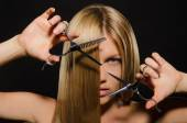 Woman with straight hair and scissors — Foto Stock