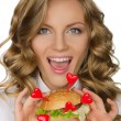 Smiling young woman with hamburger from hearts  — Stock Photo #63202913