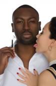 Asian licks his cheek dark-skinned men with razor — Stock Photo