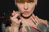 Charming blonde with tattoo machine and for them — Stock Photo