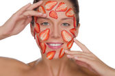 Happy woman with mask of strawberries — Stock Photo