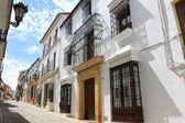Narrow hilly street in Ronda — Stock Photo