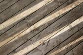 Sun shines through on wooden boards background — Stock Photo