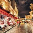 Tourists and locals walk in Montmartre streets — Stock Photo #51830265