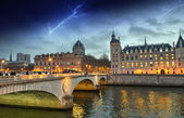 Beautiful colors of Napoleon Bridge with storm with Seine river  — Stock Photo