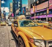 Yellow cabs in Times Square traffic — Stock Photo
