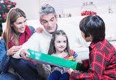 Family Scene. Parents With Children Opening Presents In Front Of — Stock Photo
