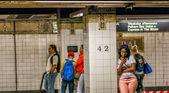 Passengers await subway train — Stock Photo