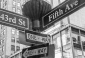 One way and street name sign in Manhattan — Stock Photo