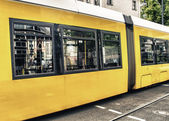 Yellow tram on city streets — Foto Stock