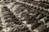 Market sale of shoes on the sidewalk road — Stock Photo
