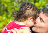 Father's  kiss to daughter — Stock Photo