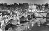 Rome. Lungotevere at night with city bridge — Stock Photo