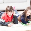 Brother and sister enjoying gifts — Stock Photo #54719879