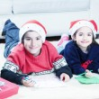 Brother and sister enjoying gifts — Stock Photo #54719901