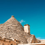Trulli in the southern Italian town of Alberobello, Apulia, Ital — Stock Photo #55203707