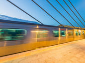 Train speeding up on a station — Stock Photo