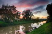 Sunset colors of fall with river reflections — Stock Photo