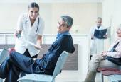 Doctors and patients speaking in the hospital — Stock Photo