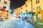 Tourists explore Montmartre streets at night — Stock Photo