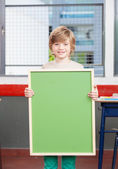 Smiling kid at primary school — Stock Photo