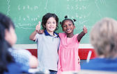 Caucasian kid and afro american girl smiling — Stock Photo