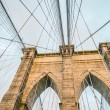 Brooklyn bridge pylon and maze of cables — Stock Photo #62250605