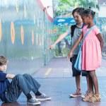 Little kids bullying kid in schoolyard — Stock Photo #62297495