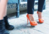 Blurred picture of women making shopping, legs detail — Stock Photo