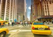 Famous yellow cabs in Manhattan avenues — Stock Photo