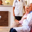 Doctors and patients in hospital — Stock Photo #65014135