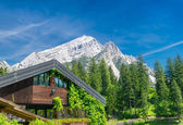 Building in the middle of mountains valley — Stock Photo